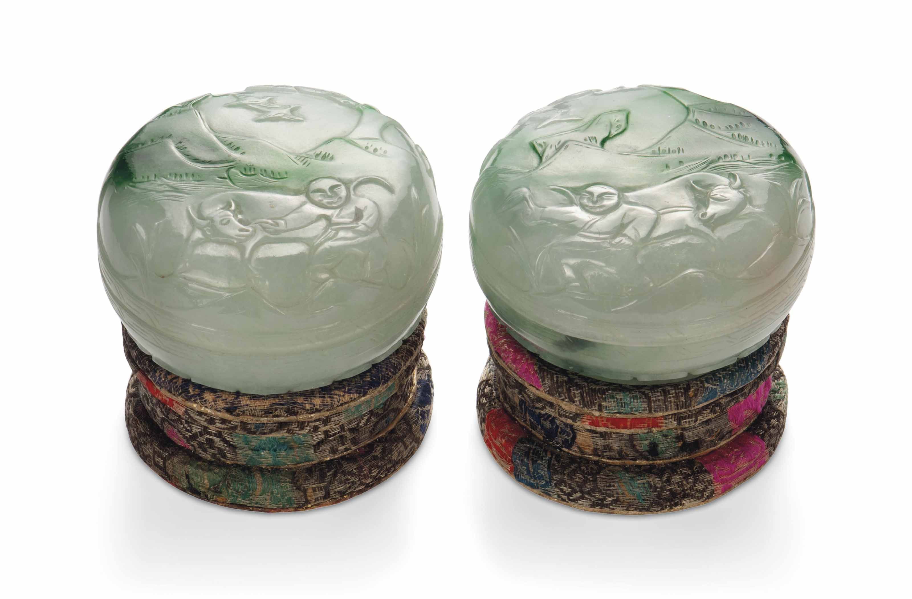 TWO CHINESE GREEN JADEITE CIRC