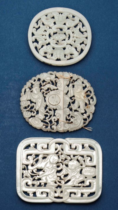 THREE CHINESE CARVED AND PIERC