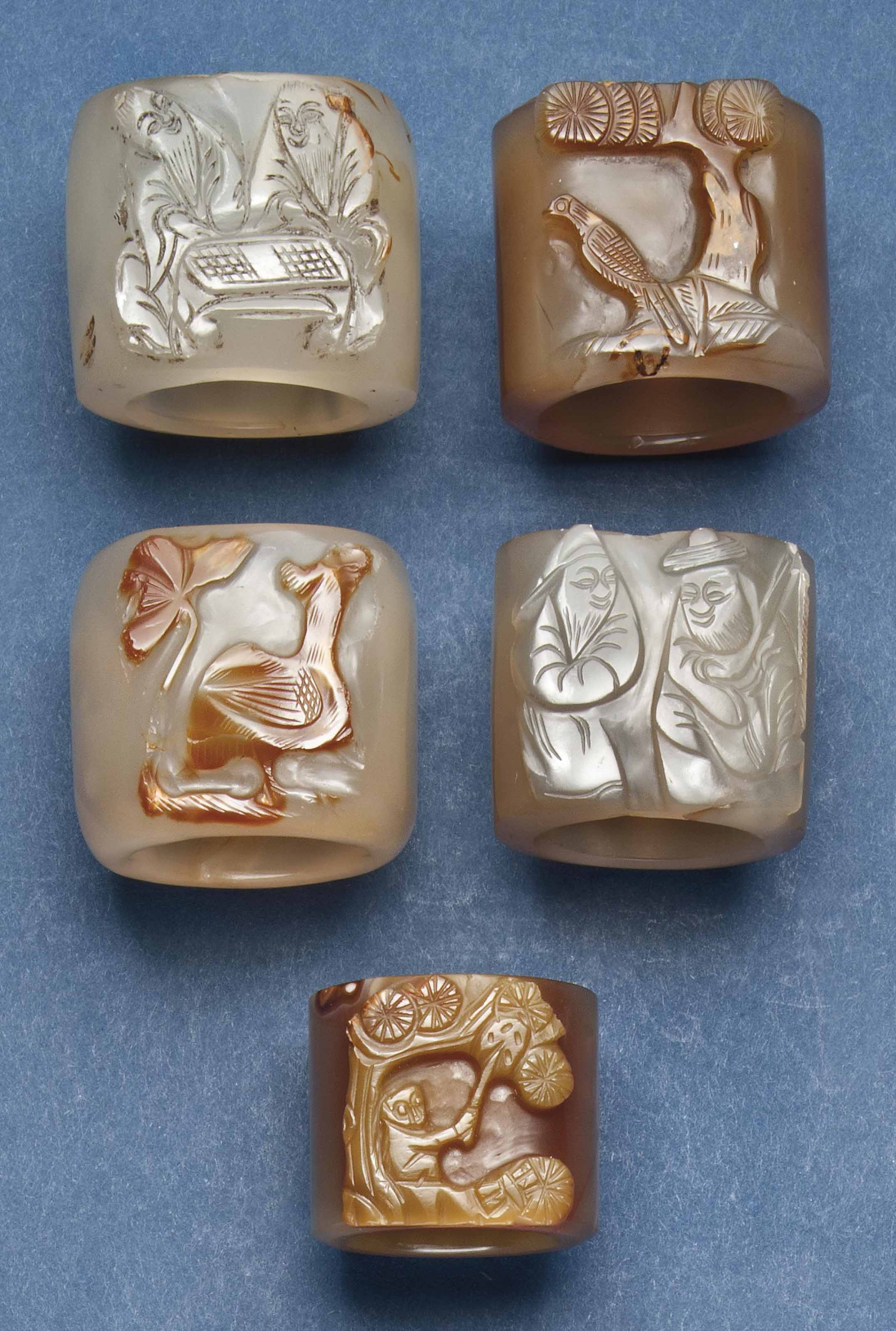 FIVE CHINESE AGATE ARCHER'S TH