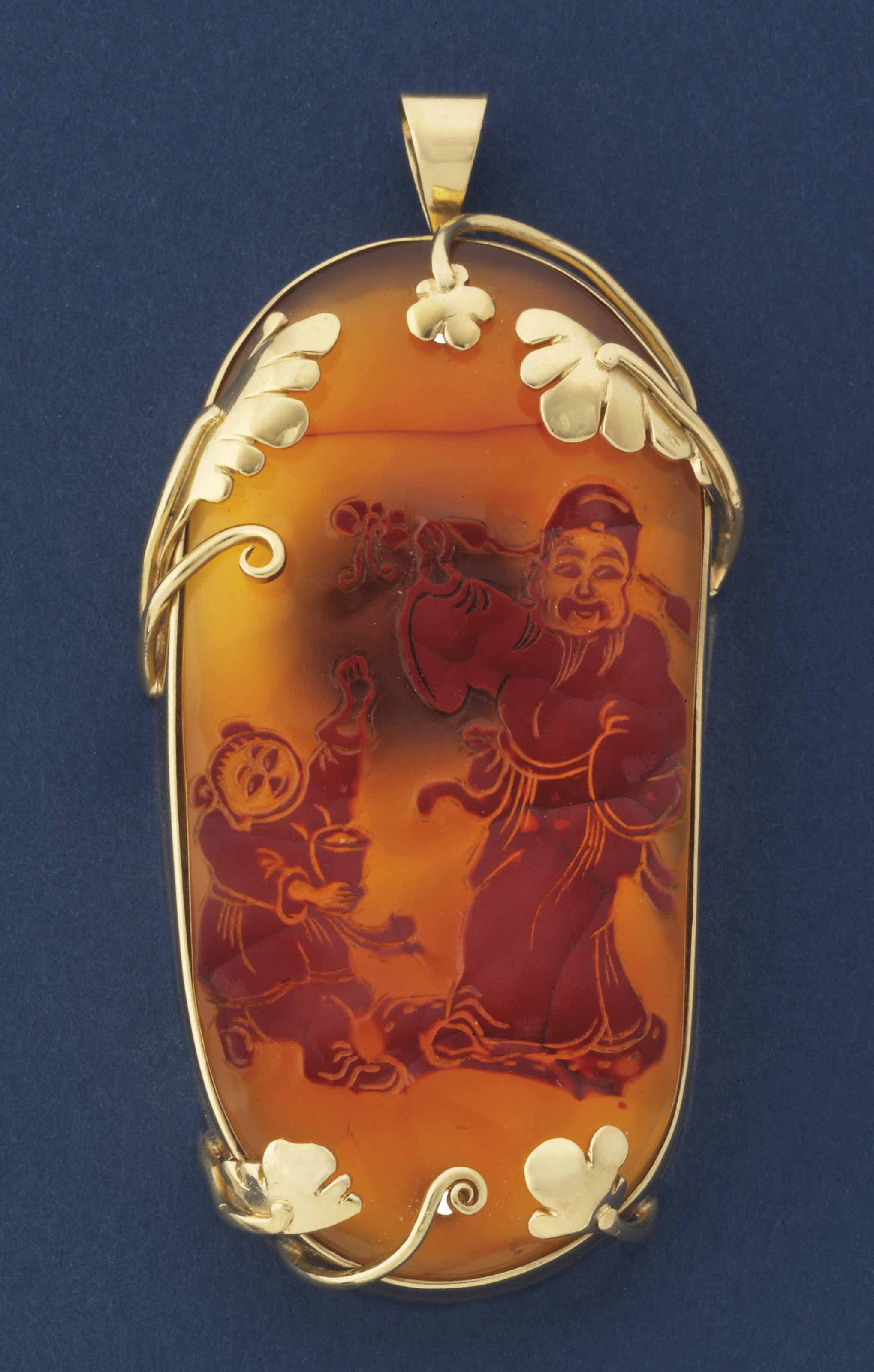 A CHINESE CARVED RED AND CARAM