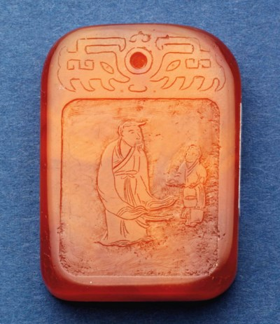 A CHINESE SMALL AMBER PLAQUE