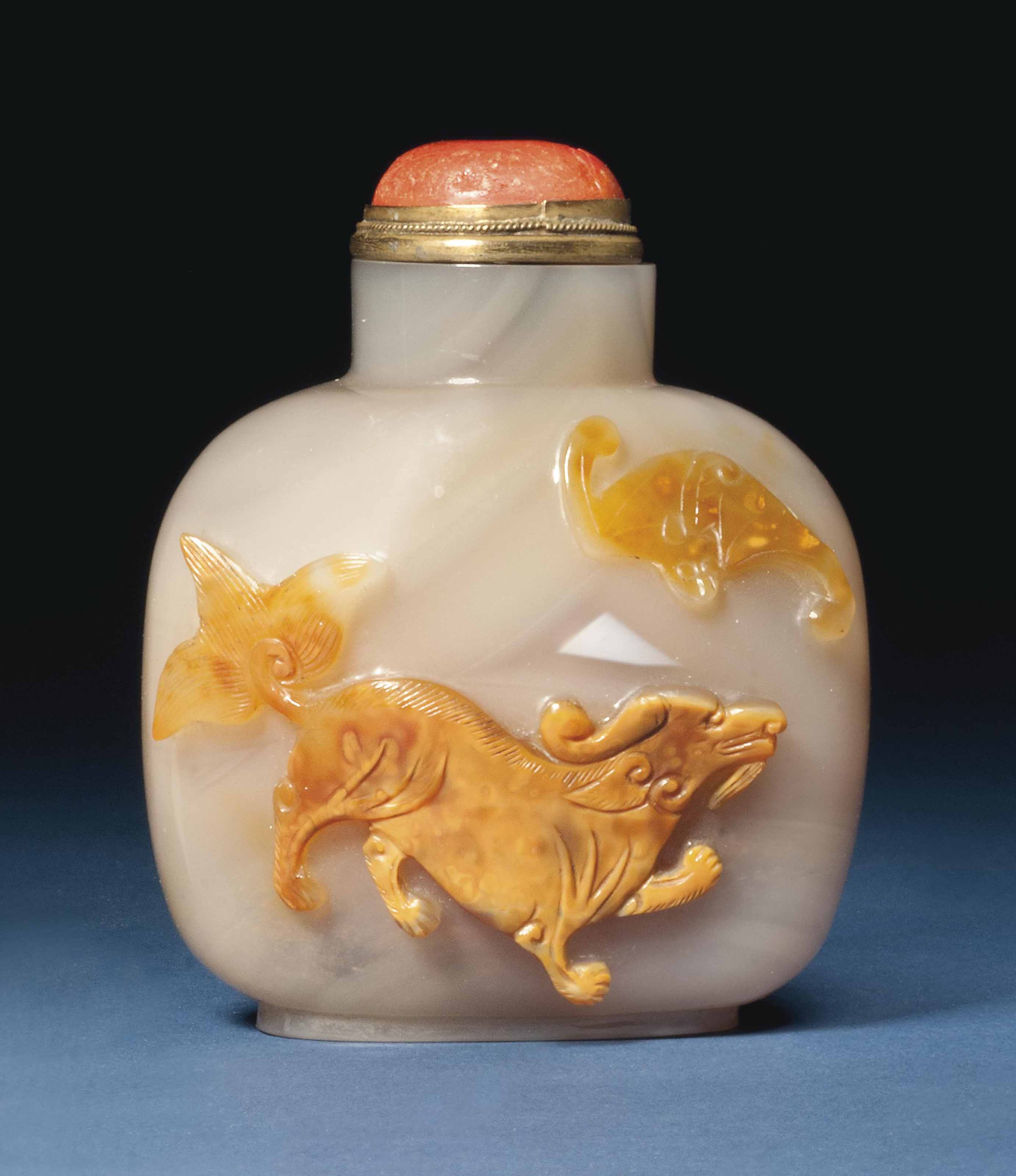 A CHINESE CARVED CARAMEL AND G