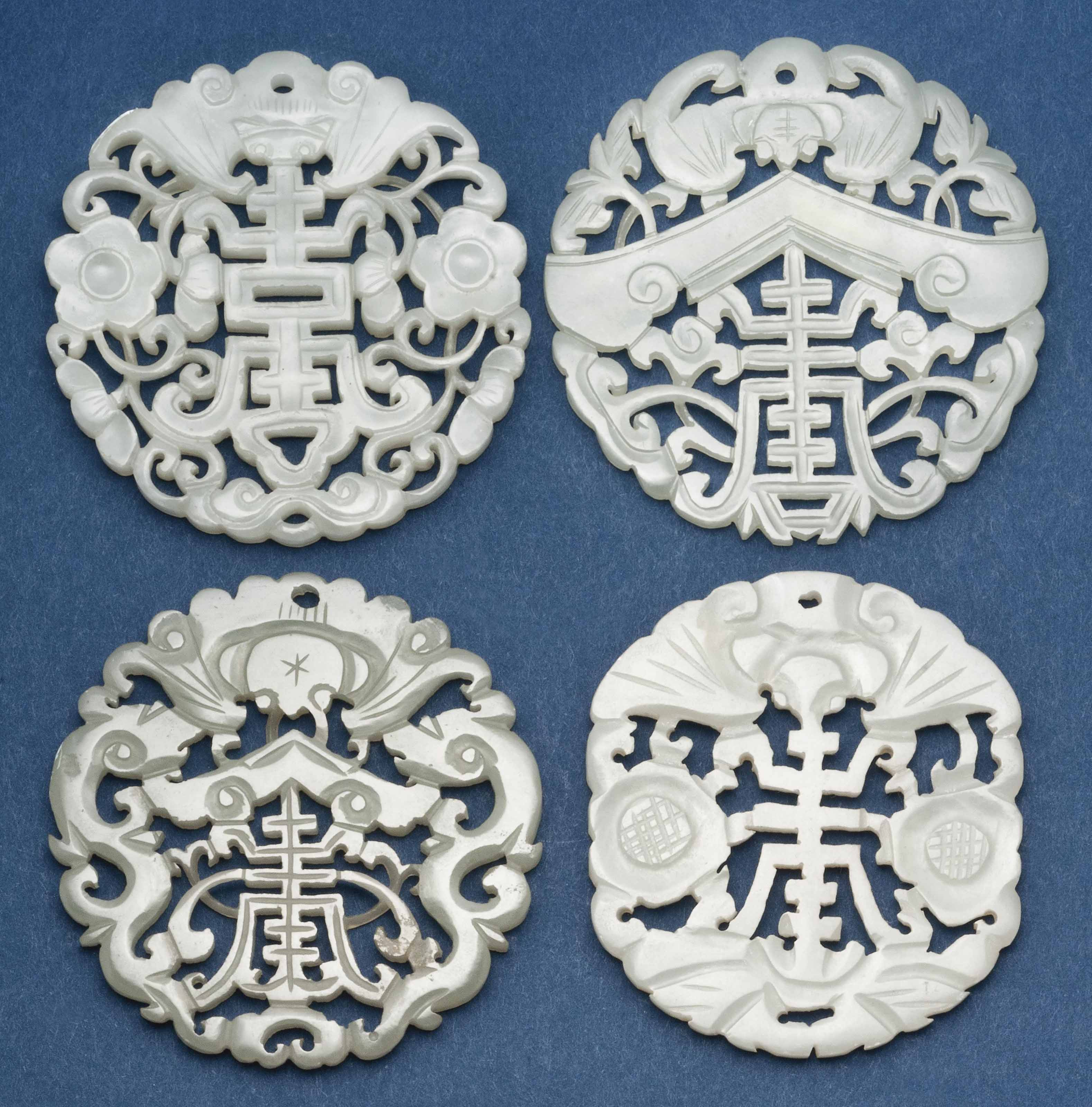 FOUR CHINESE CARVED AND PIERCE