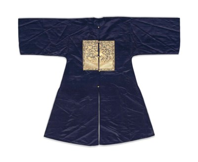 A CHINESE DARK BLUE SILK SURCO