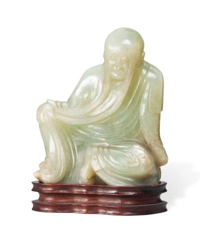 A CHINESE CELADON JADE FIGURE