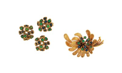 A sapphire and emerald brooch,