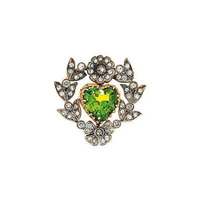 A peridot and diamond brooch