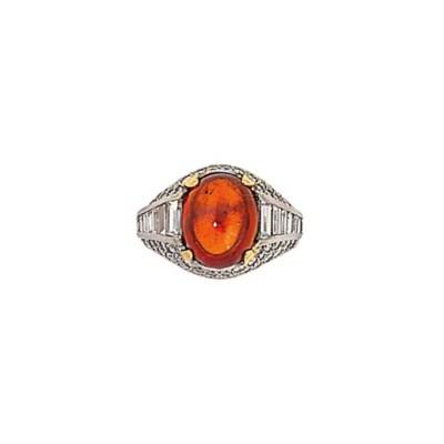 A garnet and diamond ring