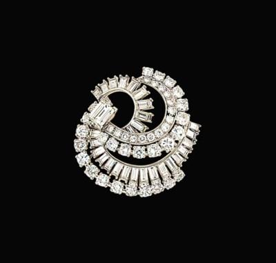 A diamond brooch, mounted by C