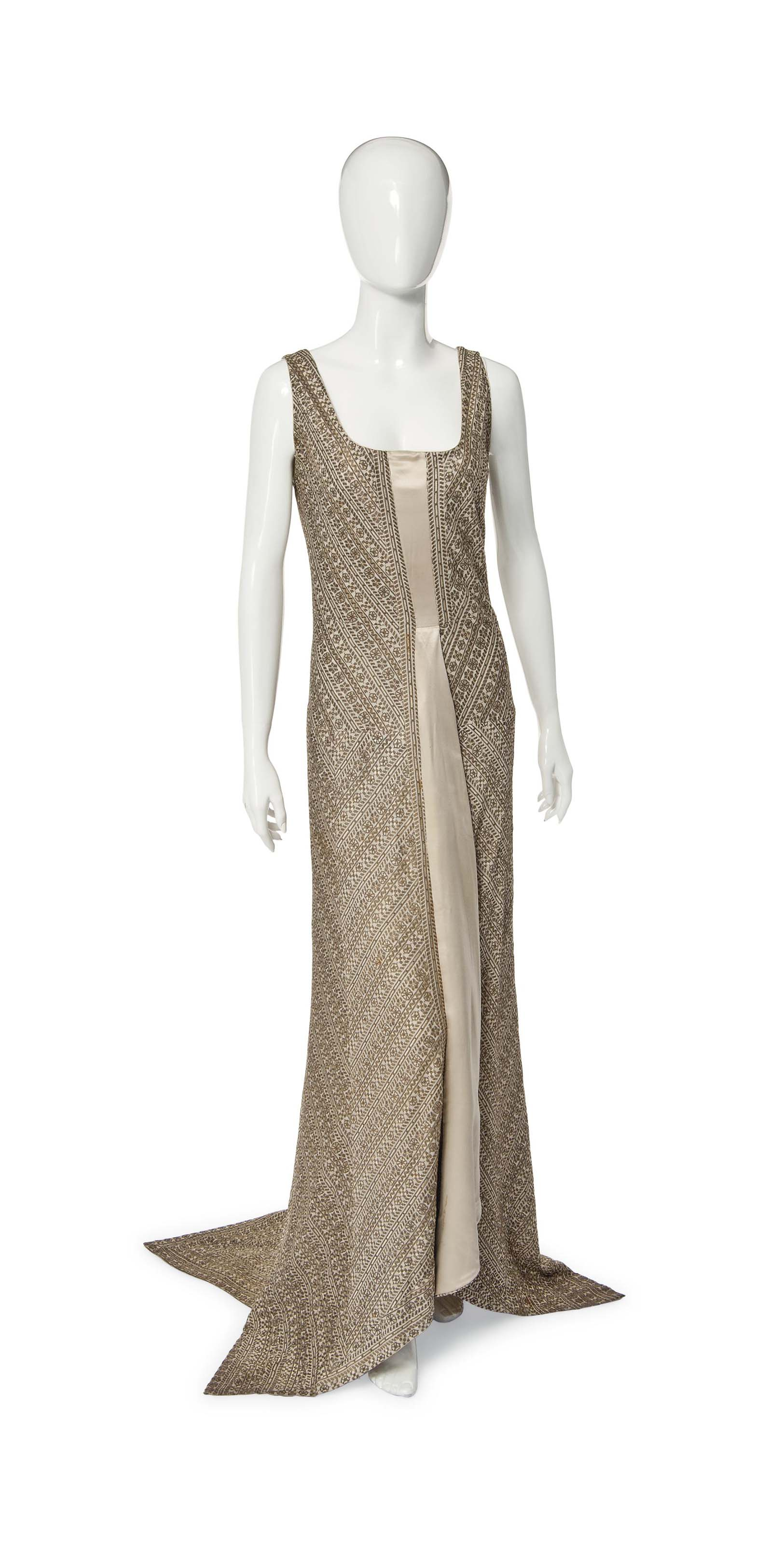 A PAUL POIRET EVENING GOWN OF GOLD AND CREAM