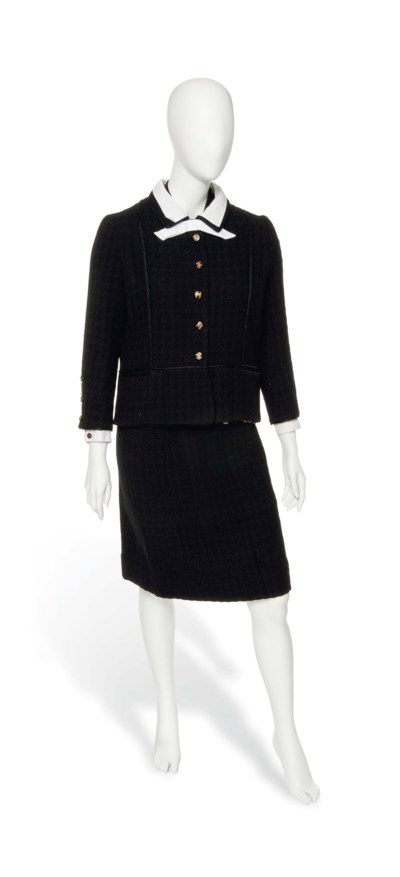 A CHANEL BLACK SKIRT SUIT AND