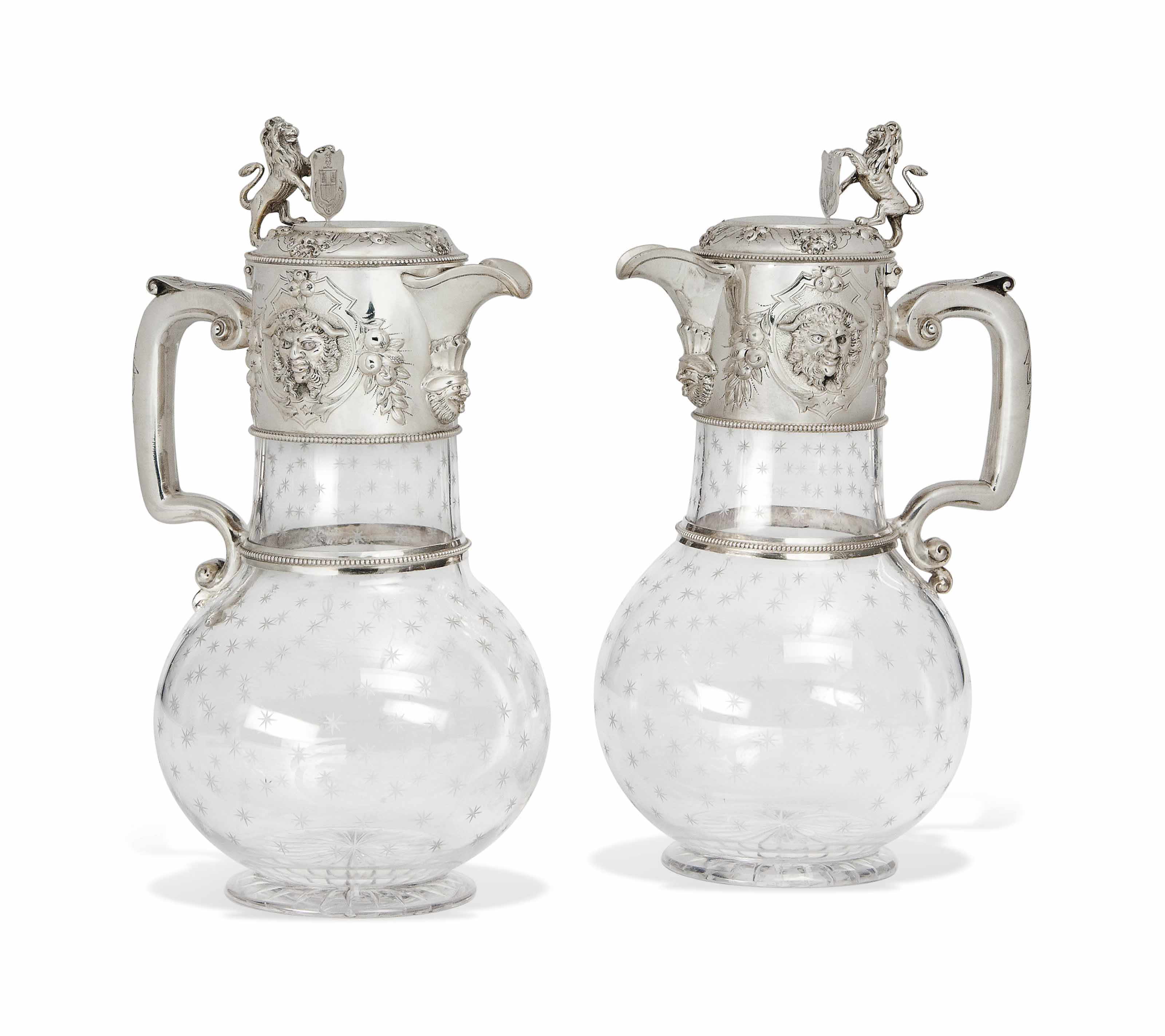 A PAIR OF VICTORIAN SILVER-MOUNTED GLASS CLARET JUGS
