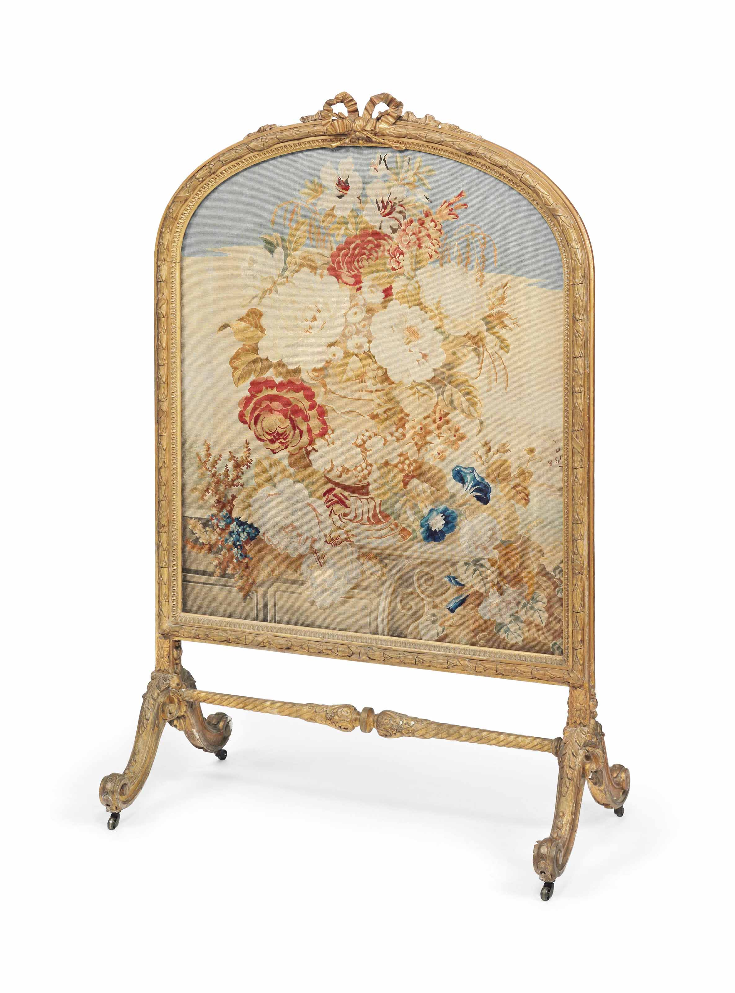 A VICTORIAN GILTWOOD COMPOSITION FIRE SCREEN