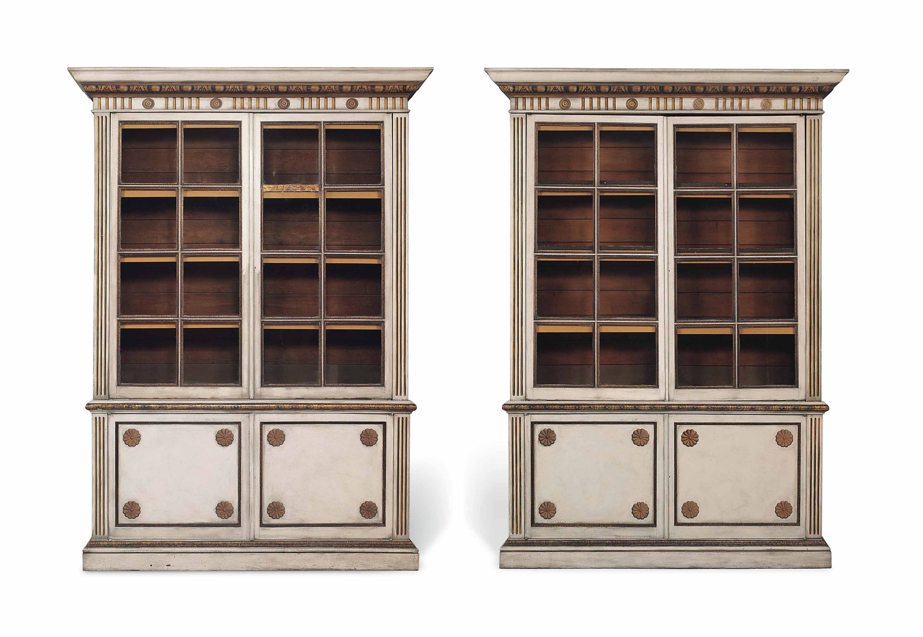 A Pair Of White Painted And Parcel Gilt Library Bookcases