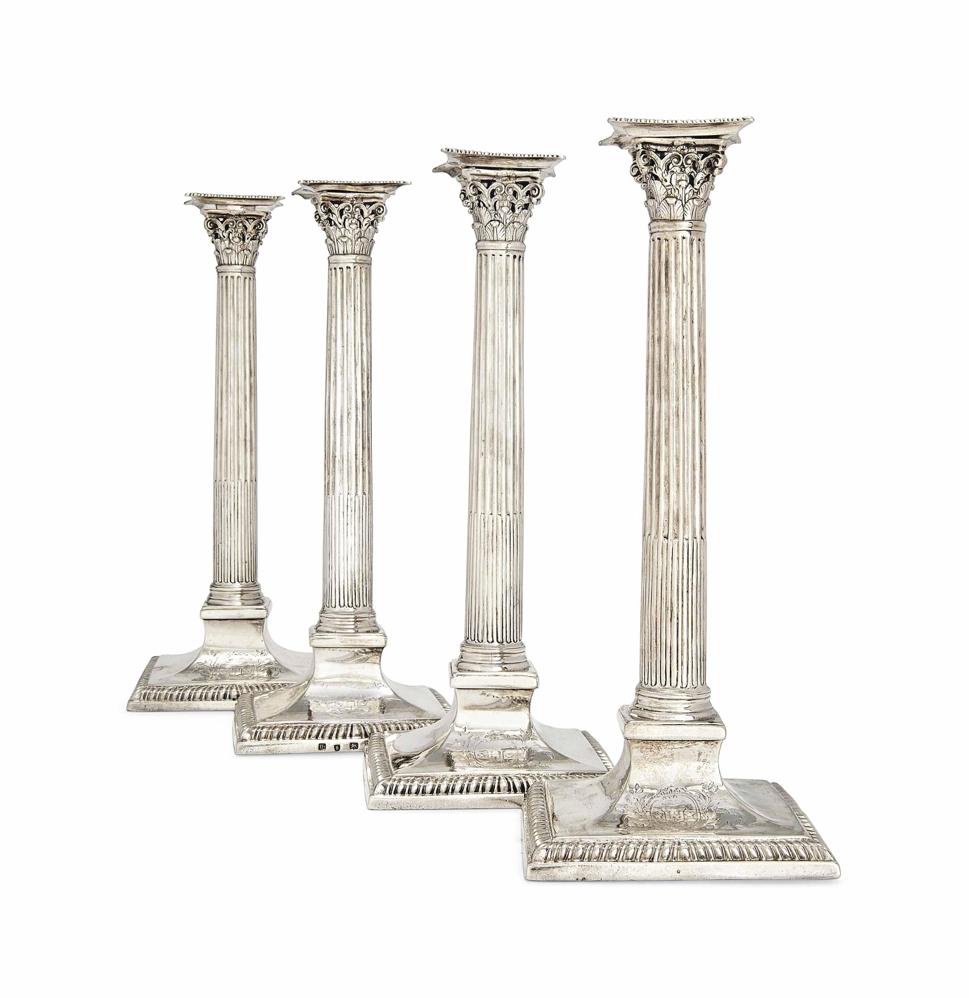 A SET OF FOUR GEORGE III SILVER CORINTHIAN COLUMN CANDLESTICKS