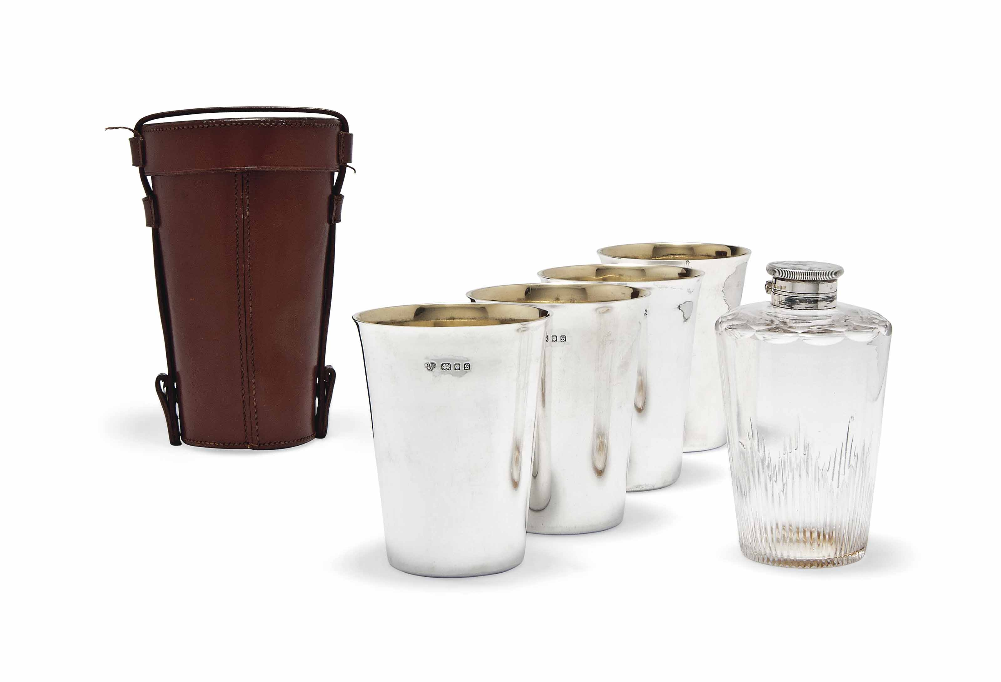 A SET OF FOUR SILVER TRAVELLING BEAKERS WITH FLASK