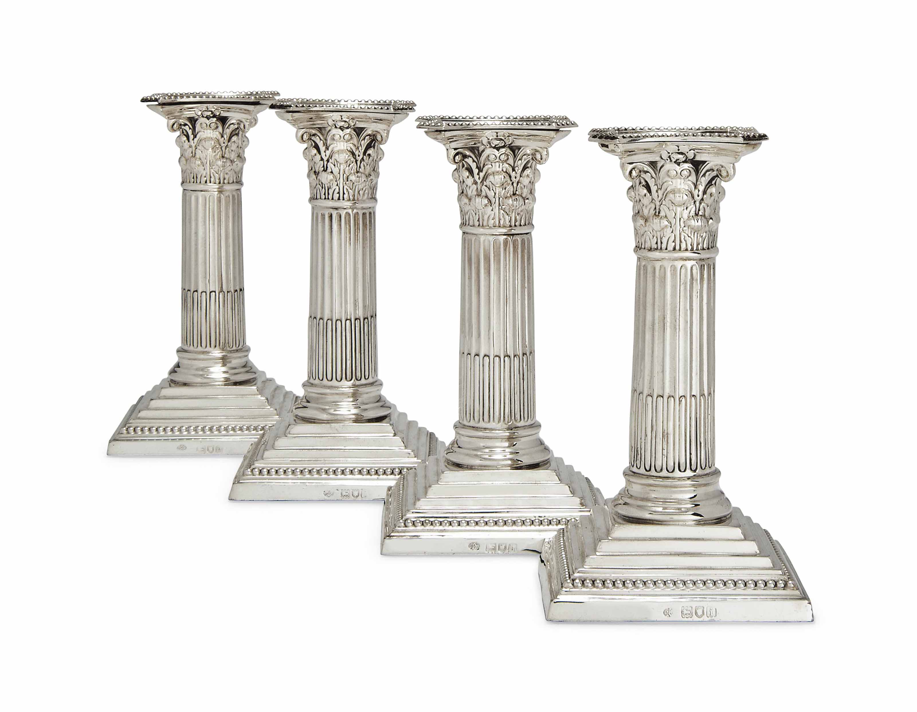 A MATCHED SET OF FOUR EDWARDIAN SILVER DWARF CORINTHIAN COLUMN CANDLESTICKS