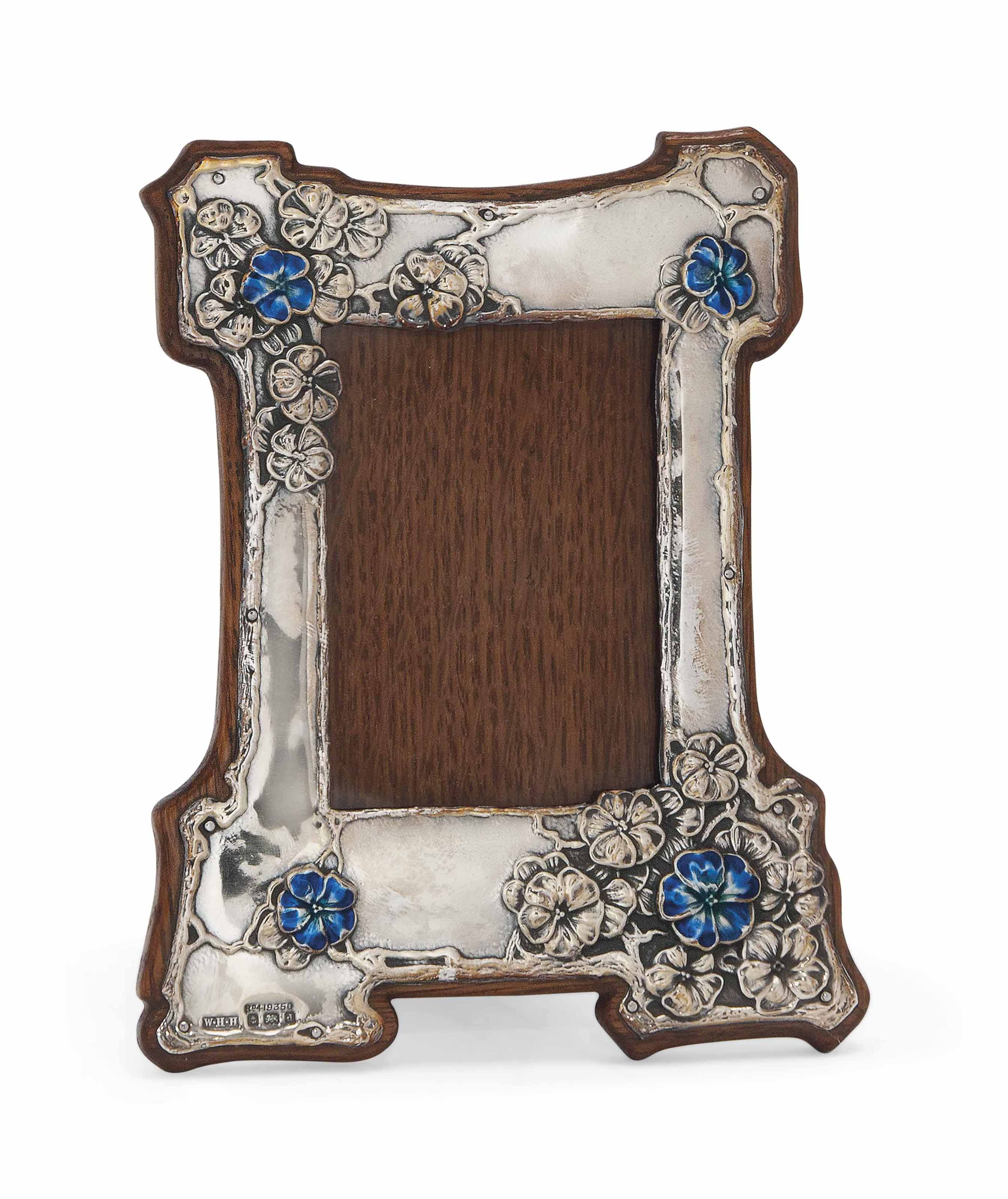 A W.H. HASELER SILVER AND ENAMEL PHOTOGRAPH FRAME