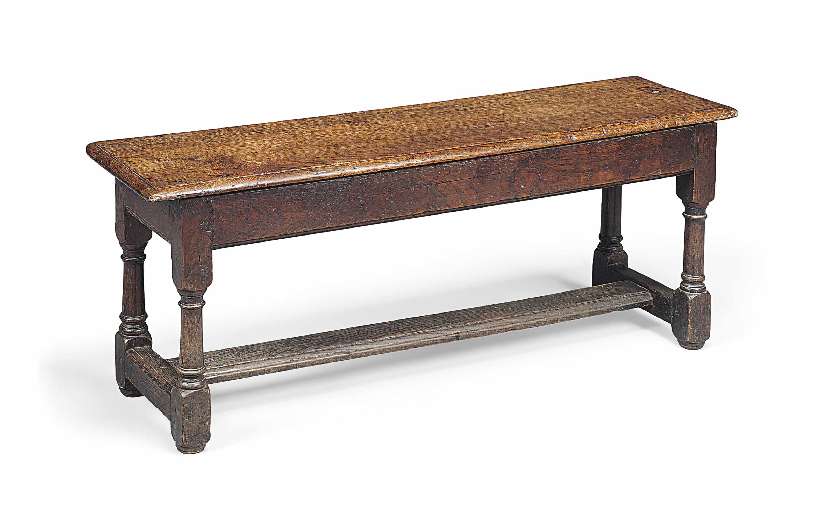 A CHARLES II OAK LONG STOOL