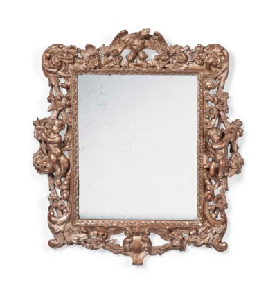 A SILVERED-WOOD WALL MIRROR
