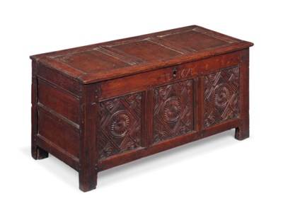 A SMALL CHARLES II OAK PANELLE