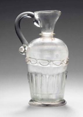 AN ENGLISH GLASS DECANTER-JUG