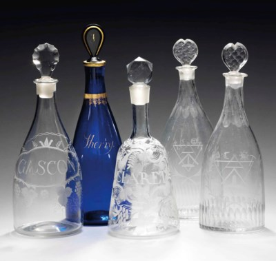 FIVE ENGLISH GLASS DECANTERS