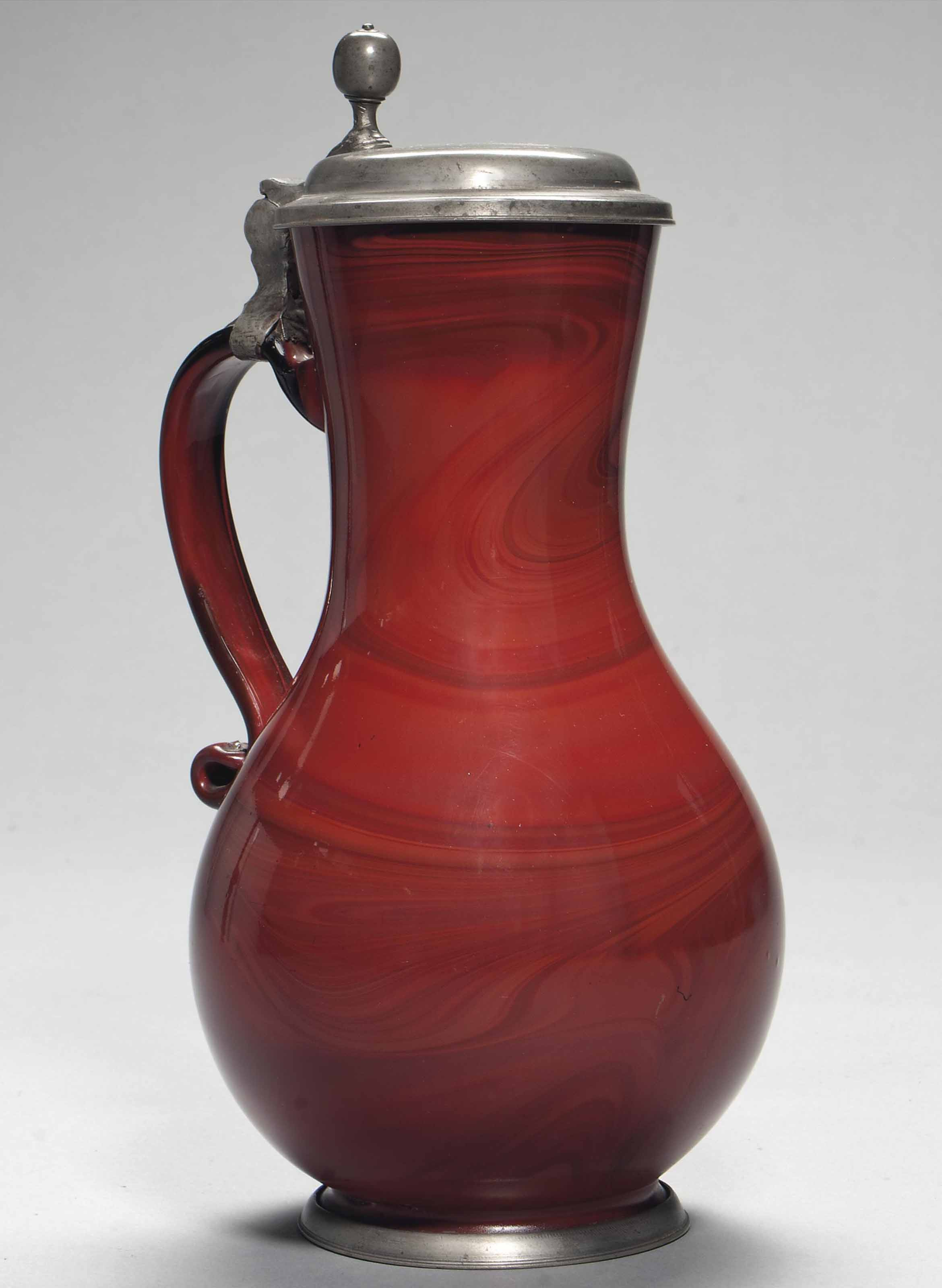 A POLISHED RED 'AGATE' GLASS P