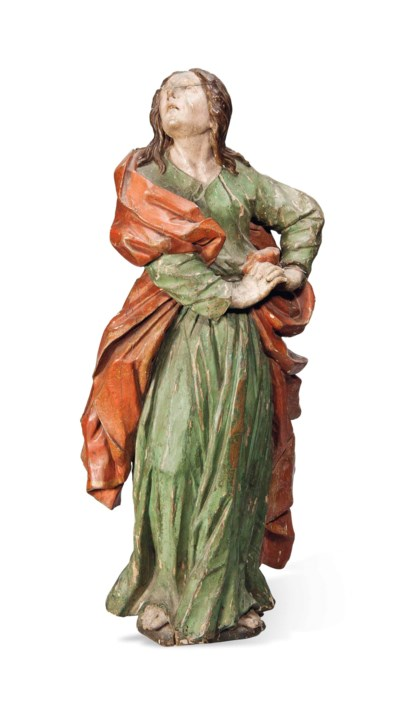 A SOUTH GERMAN CARVED WOOD AND
