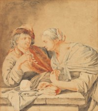 A couple at a table with bread and cheese