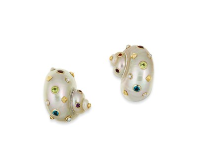A pair of shell and gem earrin