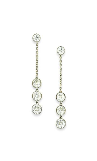 A pair of diamond pendent earr