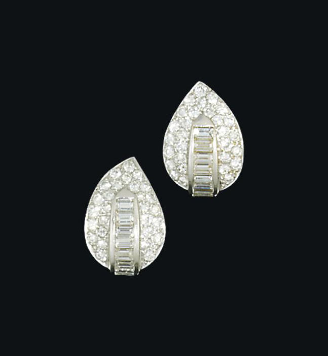 A pair of diamond set earrings