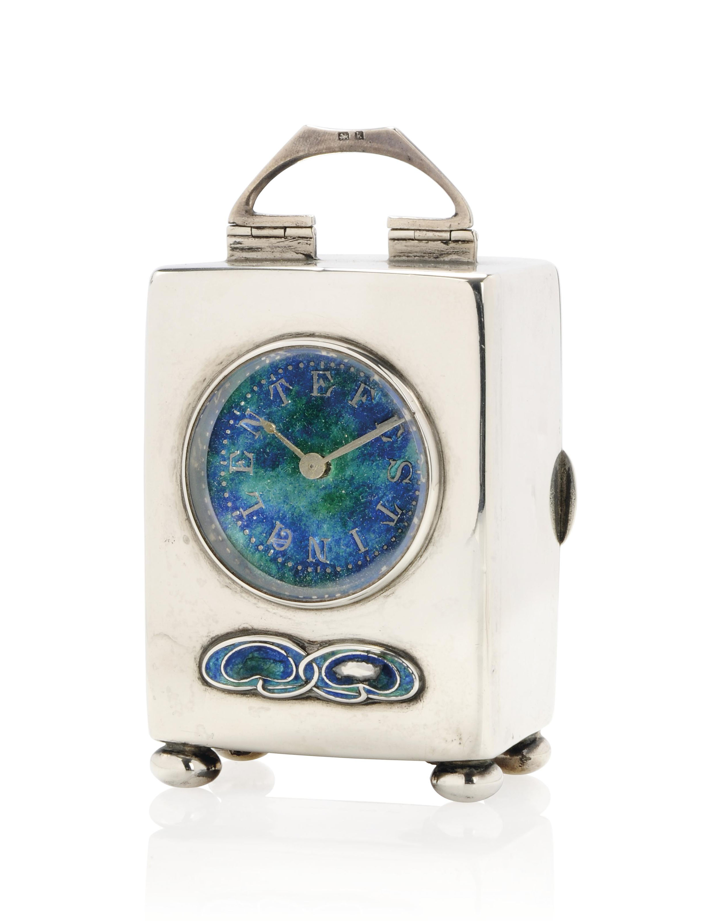 A SMALL LIBERTY & CO SILVER AND ENAMEL TIMEPIECE