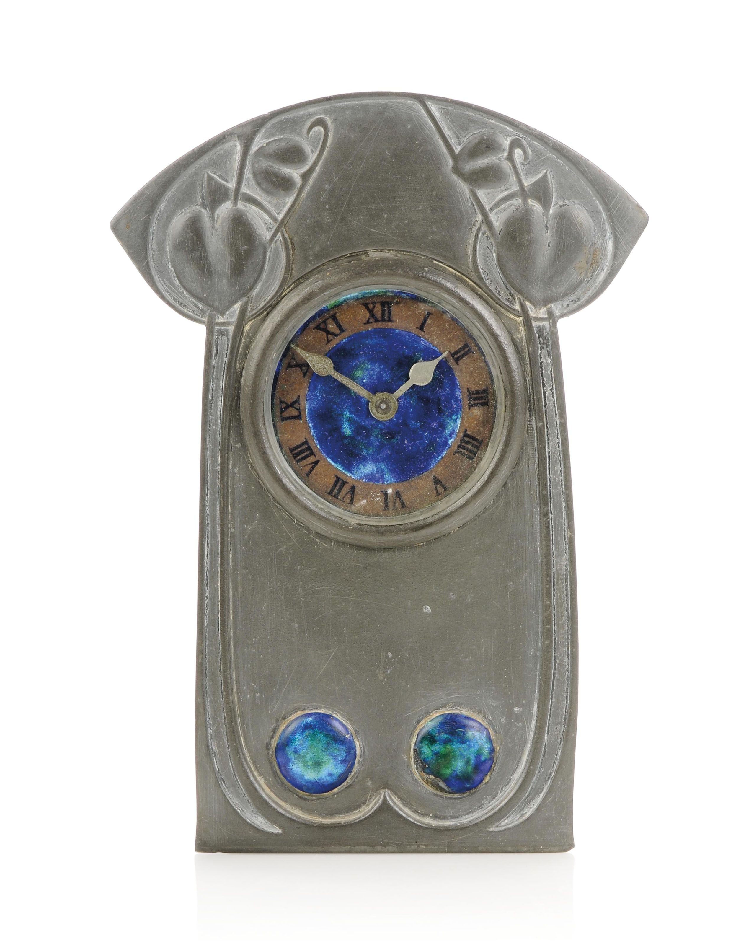 AN ARCHIBALD KNOX FOR LIBERTY & CO PEWTER AND ENAMEL TIMEPIECE
