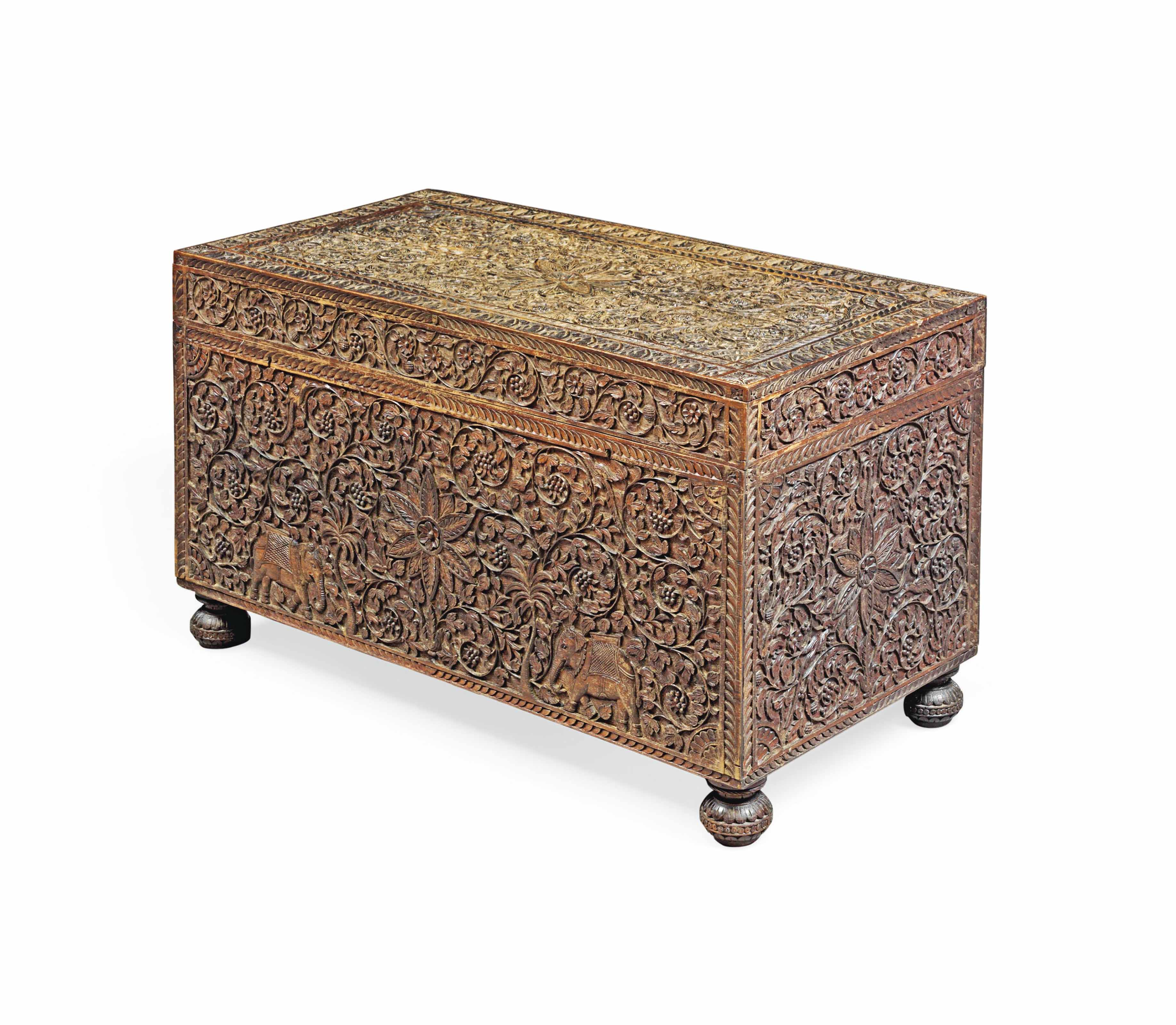A LARGE CARVED WOOD CHEST