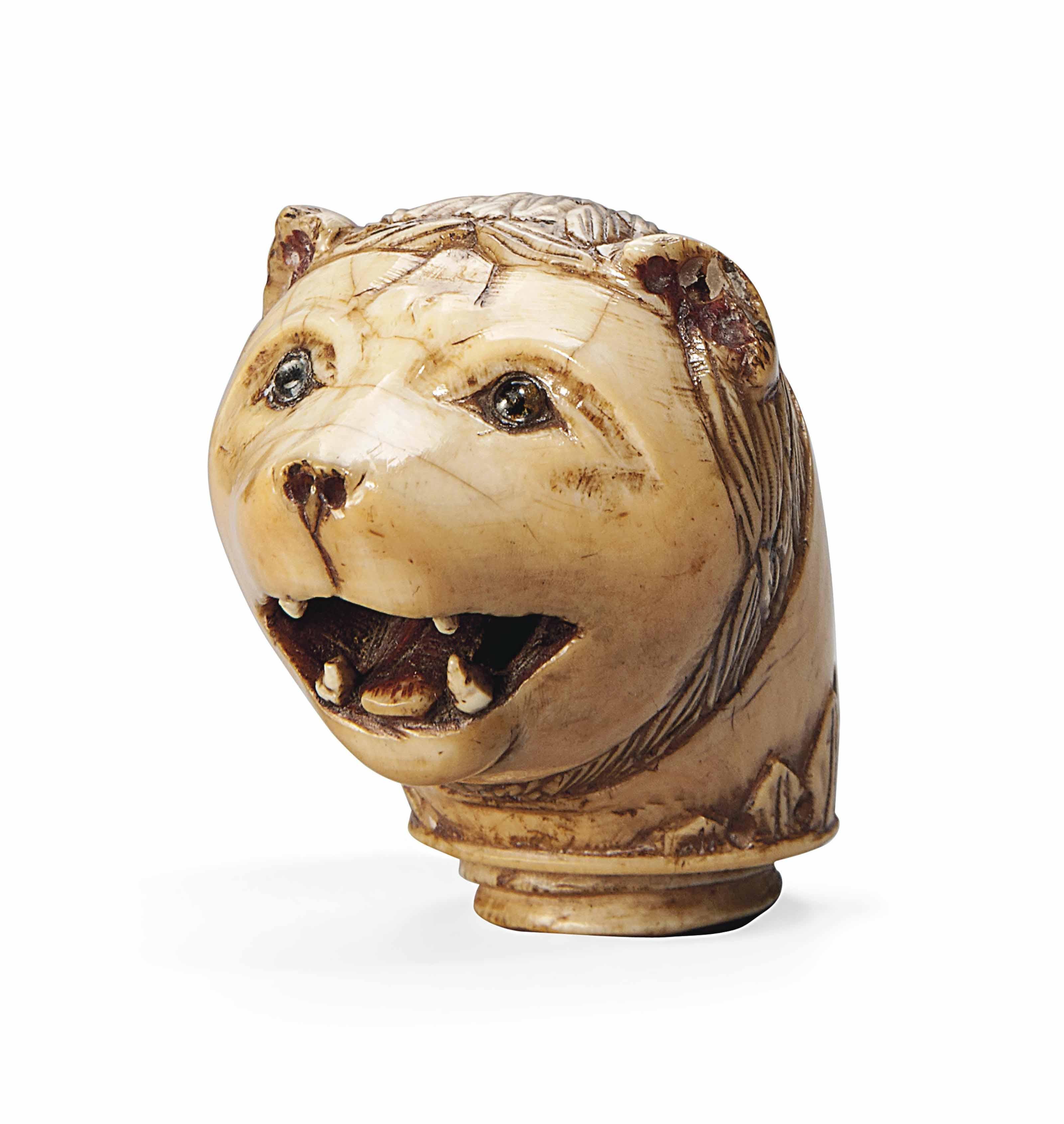 A GEMSET IVORY HEAD OF A BEAR