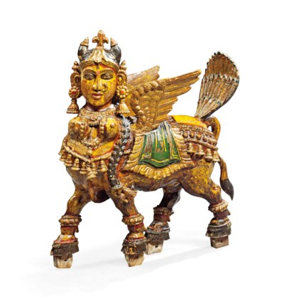 A PAINTED CARVED WOOD FIGURE O