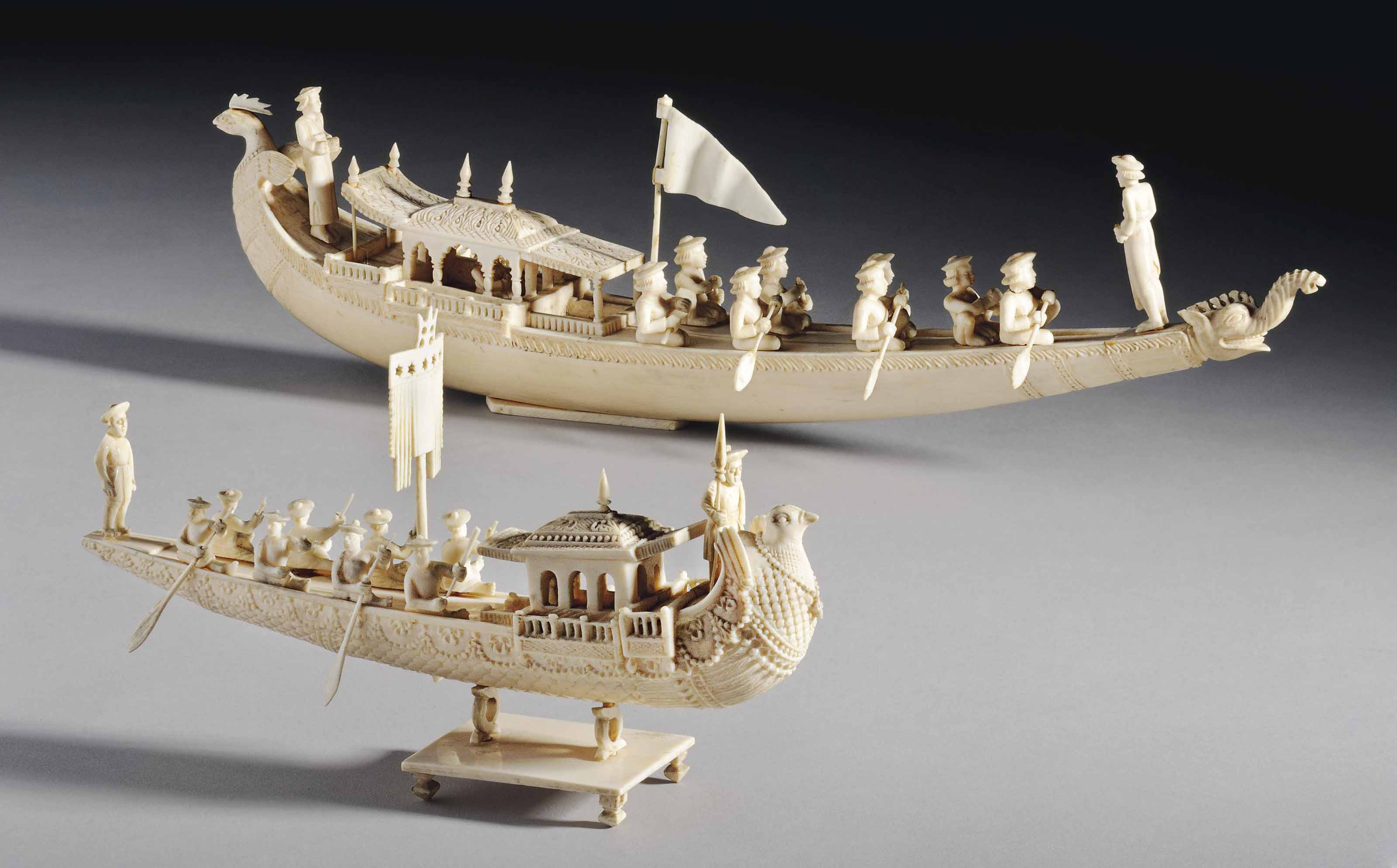 TWO IVORY MODELS OF BOATS