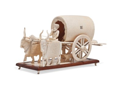 A LARGE IVORY MODEL OF AN OXEN