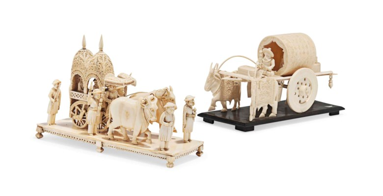 TWO IVORY MODELS OF OXEN-DRAWN