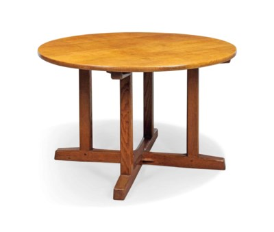 A CIRCULAR OAK TABLE DESIGNED
