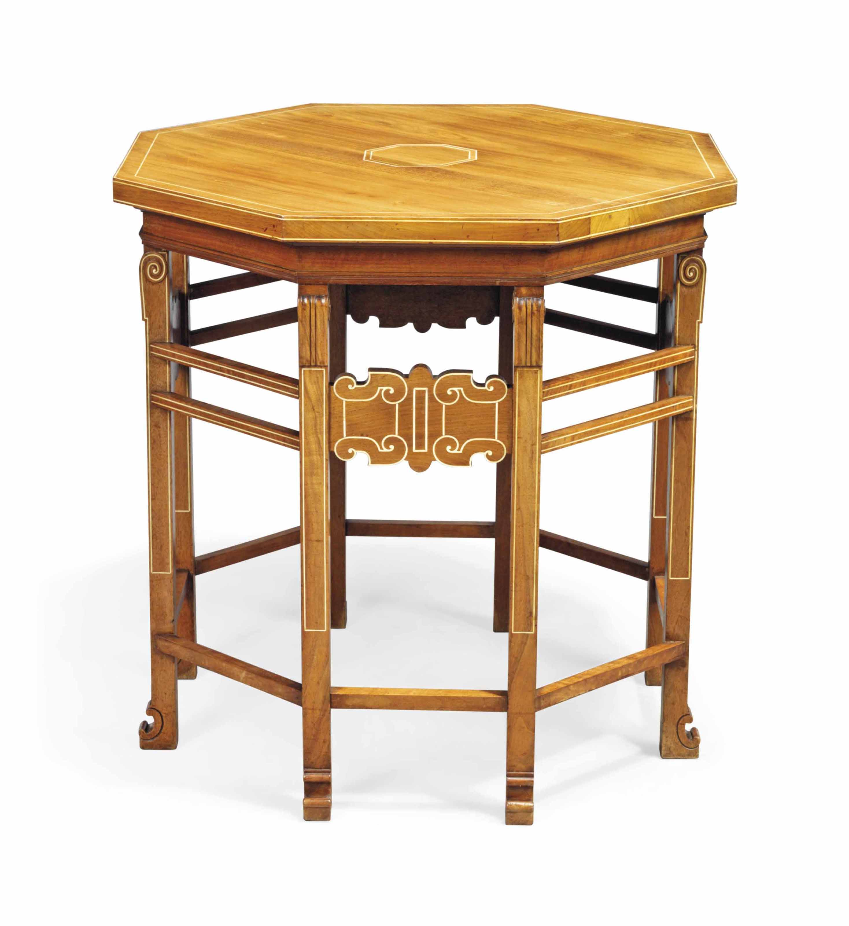 AN OCTAGONAL WALNUT OCCASIONAL TABLE IN THE STYLE OF EDWIN LUTYENS (1869-1944)