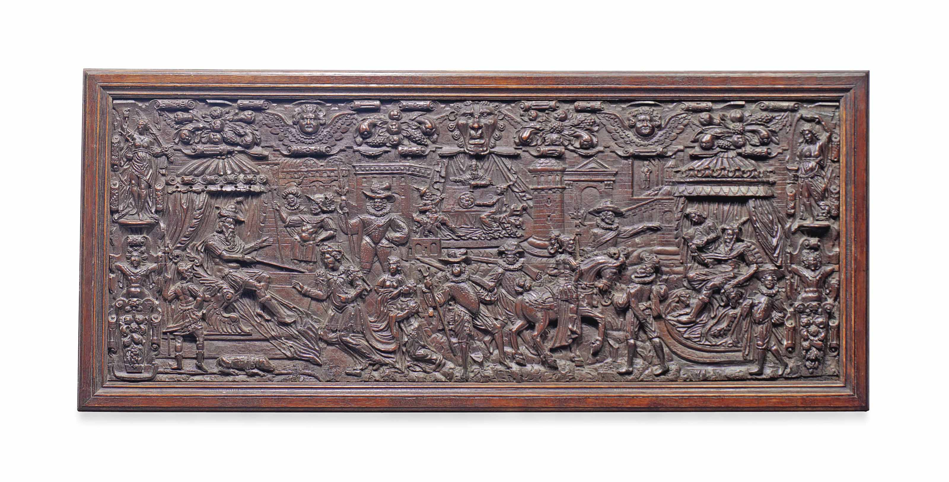 A LARGE CARVED OAK PANEL