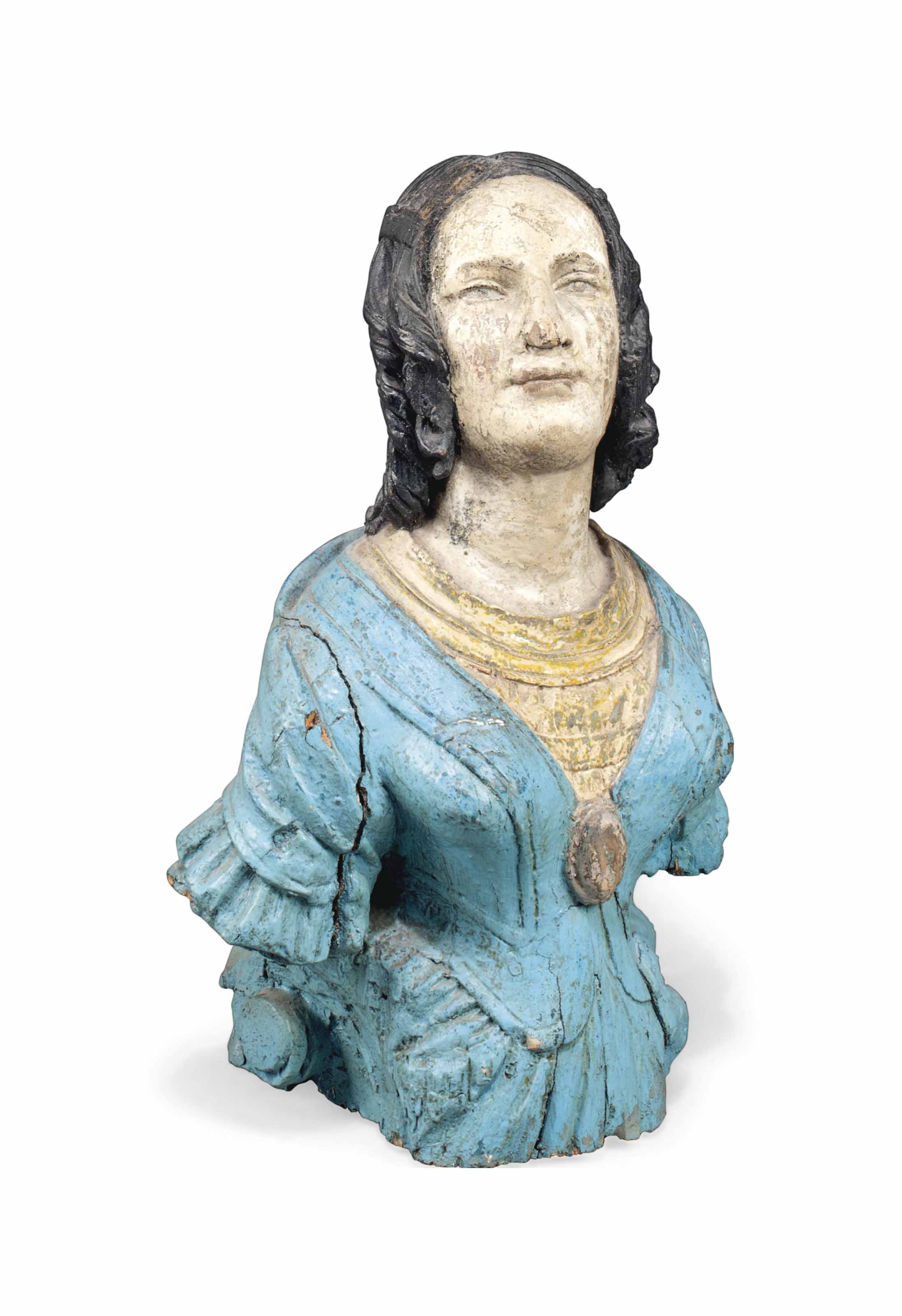 A POLYCHROME WOOD SHIP'S FIGUR