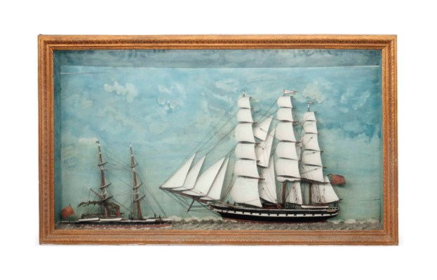 A LARGE FRAMED DIORAMA OF TWO