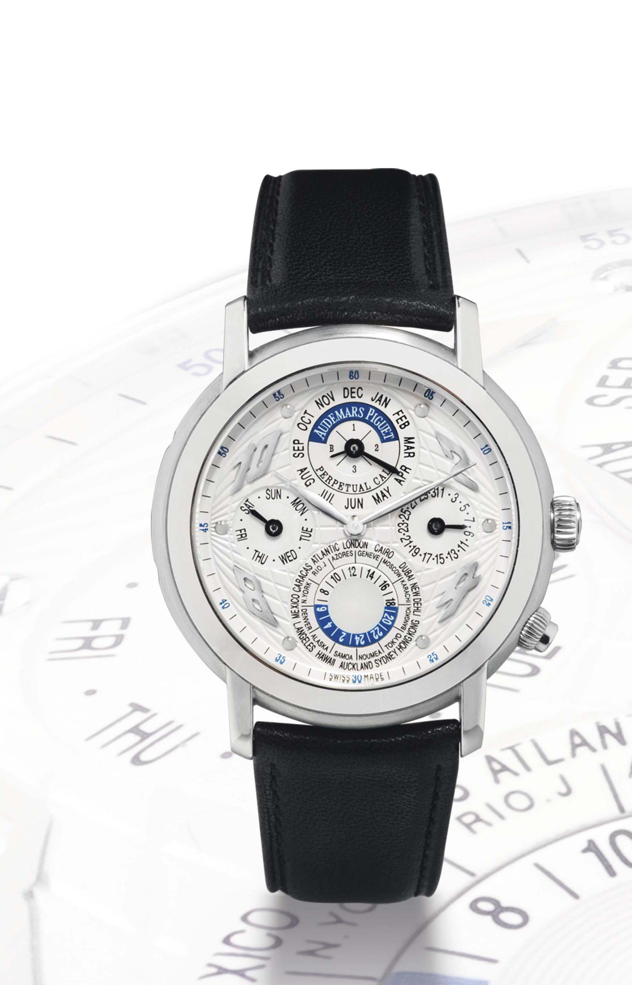 AUDEMARS PIGUET. A VERY FINE AND RARE 18K WHITE GOLD AUTOMATIC PERPETUAL CALENDAR WORLD TIME WRISTWATCH WITH LEAP YEAR INDICATION SIGNED AUDEMARS PIGUET, JULES AUDEMARS, AUTOMATIQUE, QUANTIEME PERPETUEL, METROPOLIS MODEL, MOVEMENT NO.506'135, CASE NO.E61459, CIRCA 2002