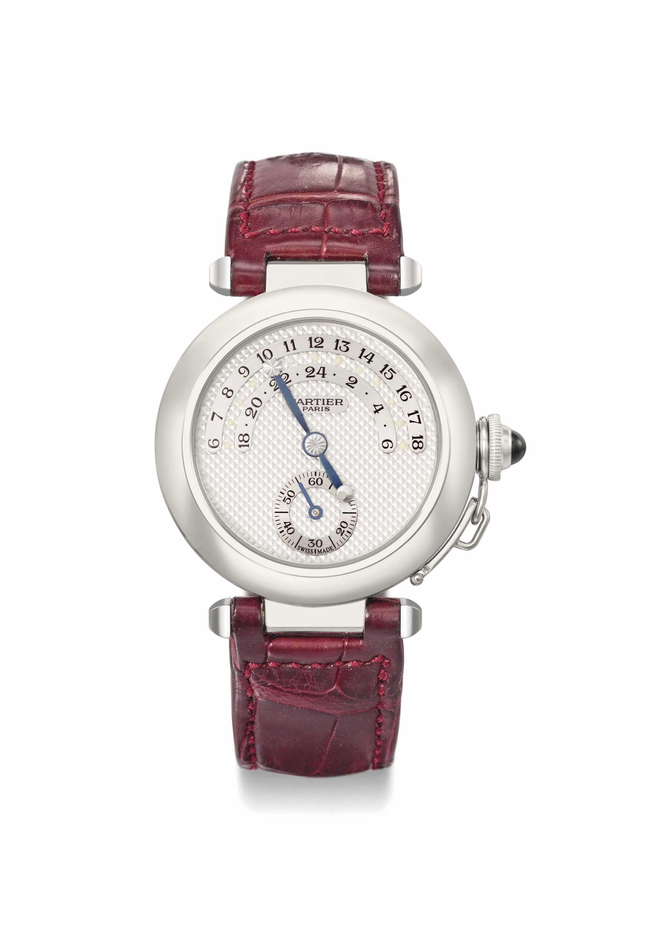 Cartier. A limited edition 18K white gold automatic jump hour wristwatch with night and day display