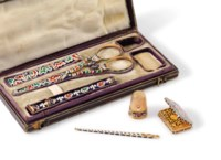 """Attributed to Jean-François Bautte & Cie. A gold and champlevé enamel sewing kit with """"mauresque"""" decoration in a brown case"""