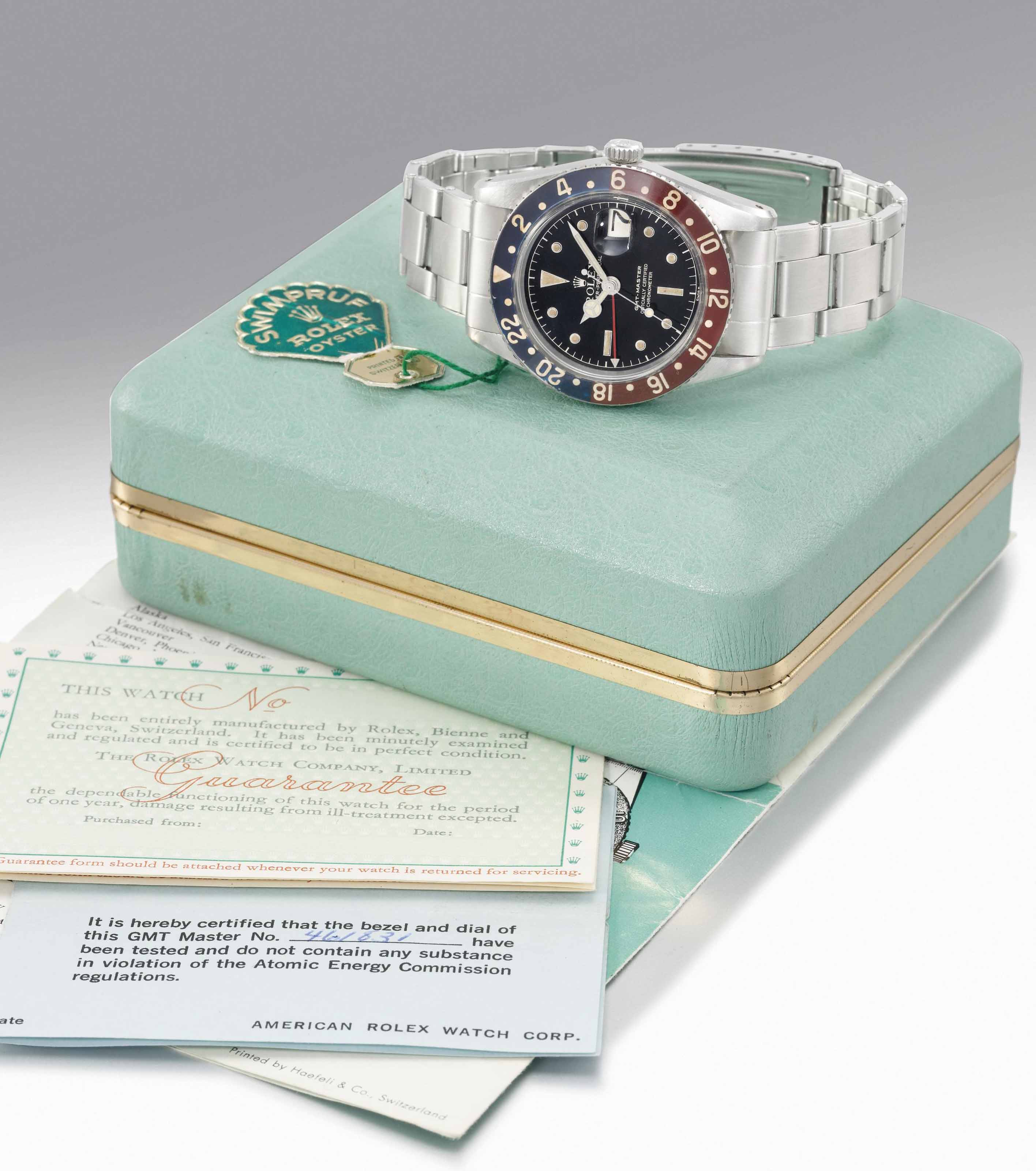 Rolex. A rare stainless steel dual time wristwatch with sweep centre seconds, date, expandable bracelet, bakelite bezel, Guarantee and box